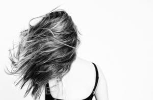 women swinging hair after laser hair rejuvenation