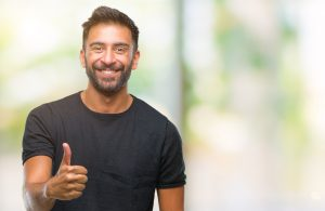 Man giving thumbs up to work done by Eldorado Hair replacement